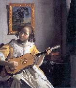 Youg woman playing a guitar Johannes Vermeer